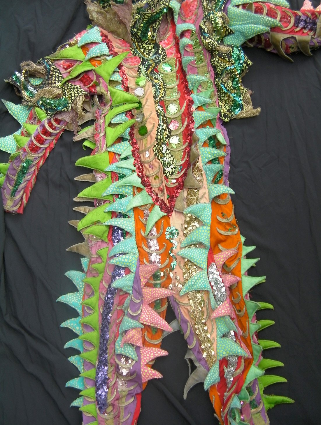 A close up of the Chameleon costume